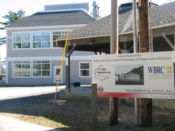 A sign marks the spot Saturday, April 7, 2012, where a new laboratory building has been completed at Mount Desert Island Biological Laboratory's campus in the Bar Harbor village of Salisbury Cove. The $5 million facility, seen in the background, was largely paid for with federal stimulus funds and will house the lab's regenerative research program.