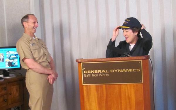 U.S. Sen. Susan Collins dons a cap bearing the name of the first next-generation destroyer, the future U.S.S. Zumwalt, at Bath Iron Works on Wednesday, April 4, 2012. Looking on is Chief of Naval Operations Adm. Jonathan Greenert, who toured some of the shipyard's facilities on Wednesday.