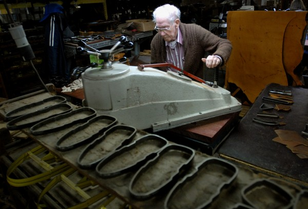 Chester Terrill, who will turn 86 on April 30, uses cutting dies to cut leather at Highland Shoe in Brewer on Thursday. Terrill, who has worked in the shoemaking industry since 1948, has been employed at Highland for about 8 years.