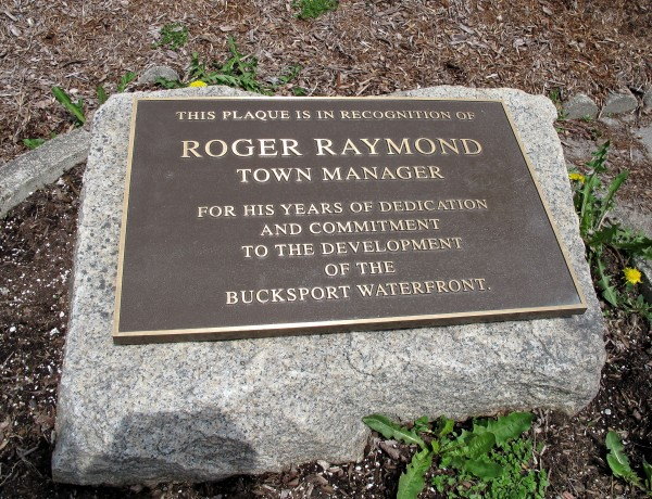 Bucksport residents dedicated this plaque along the waterfront walkway to retired town manager Roger Raymond, who was instrumental in restoring the area.