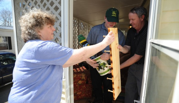 Cindy (left) and Gary Burke (right) help their son Casey as he moves into a home on Tuesday, April 17, 2012 with another young man and trained staff members who can assit Casey with his autism.