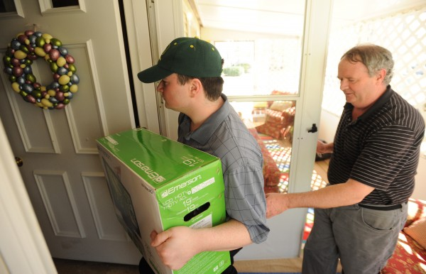 Casey Burke gets help as he loads belongings into this new home in Bangor on Tuesday, April 17, 2012. Casey has autism and poses a danger to his parents.