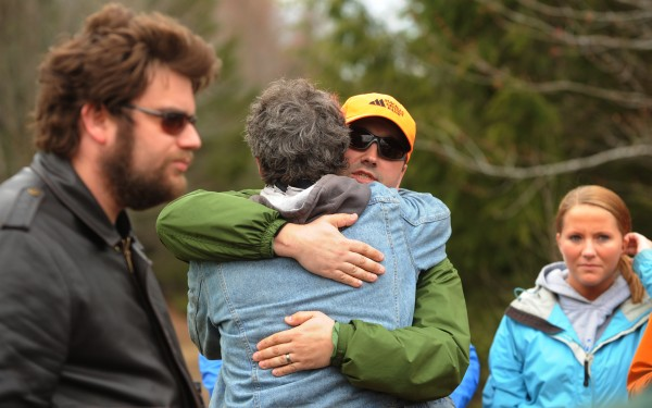 Ryan Cyr embraces Dan Levasseur (center) on Tuesday, April 24, 2012 as the pair  is surrounded by searchers near the site where Dean Levasseur went missing on Saturday, April 21, 2012.