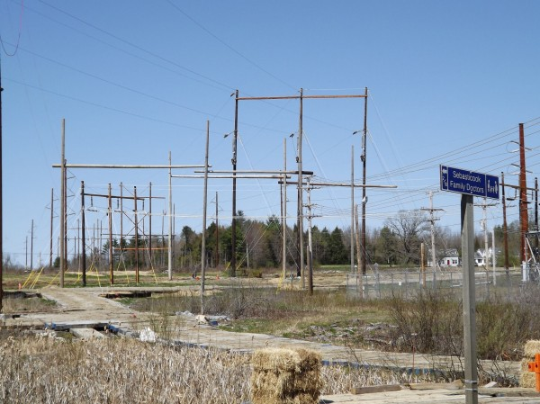 New Central Maine Power lines and poles being erected near the Pittsfield town line in Detroit on April 28, 2012.