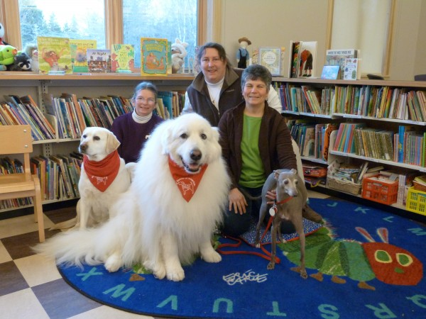 Downeast Dog Scouts Troop 159 members (from left) Robyn Douglas, Pam Bourque and Pier Carros and their dogs (from left) Jillian, Cirra and Gracie volunteer at the Swan's Island Library recently.