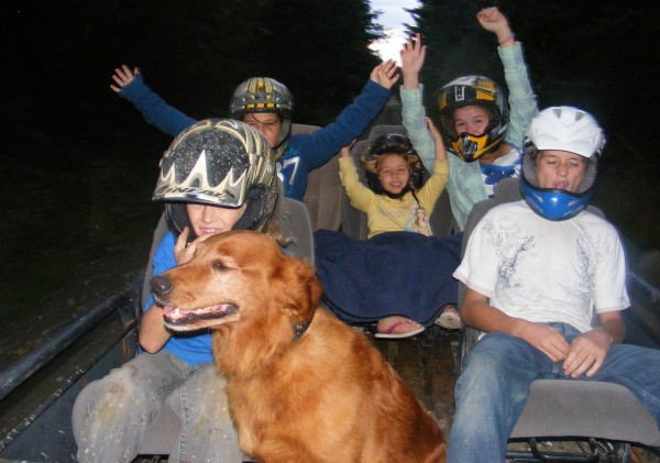 The Warren family in 2011, with Bella, on a ride through the woods.