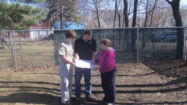 Boy Scout Mason Duplissie of Troop 1 in Brewer (left), Donna Rasche, director of the Brewer Public Library, and Dave Cote, director of Brewer Public Works, discuss the picnic table and shelter Duplissie plans to build at the library as his Eagle Scout project.