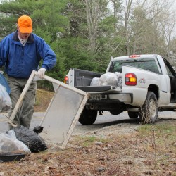 Earle Farley of Surry picks up litter that had been left alongside North Bend Road. The Surry Community Improvement Association organized the annual roadside cleanup event on Saturday, April 21, 2012, as part of Earth Day.