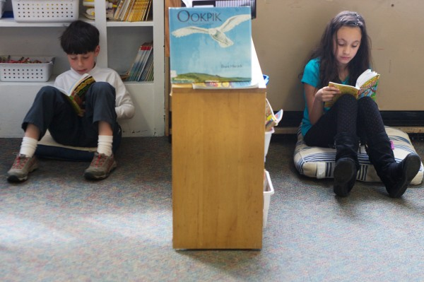 West Bath Elementary School second-graders Isaac Ensel, 8, and Aviva Feinberg, 7, read chapter books by themselves Thursday morning, April 12, 2012. Ensel was enthusiastic about his book. &quotIt's exciting and there's spies, and cheese and a mouse and it's cool,&quot said Ensel.