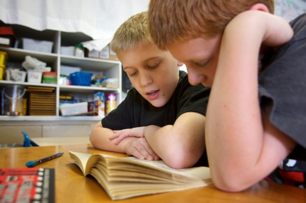 Ethan Reno (left), 8, reads &quotPunished!&quot by David Lubar aloud to his second-grade classmate Sawyer Stedman, 8, at the West Bath Elementary School Thursday morning, April 12, 2012. &quotIt's a very good book,&quot said Reno.