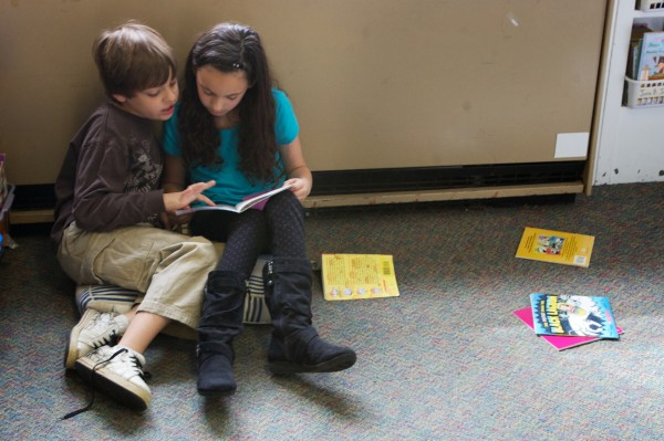 Second-grade classmates at the West Bath Elementary School, Anthony Pelletier, 8, (left) and Aviva Feinberg, 7, take turns reading aloud to each other Thursday morning, April 12, 2012.