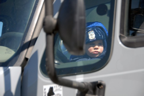 Two-year-old Caden Lary of Millinocket enjoys the front seat of an 18-wheel truck at the 2012 Lincoln Lakes Region Chamber of Commerce's Business Expo at Mattanawcook Academy of Lincoln on Saturday, April 28, 2012.