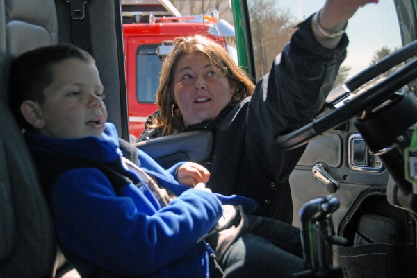 Kelly Hoxie of Lincoln points to the air horn in one of a dozen trucks on display at the 2012 Lincoln Lakes Region Chamber of Commerce's Business Expo at Mattanawcook Academy of Lincoln on Saturday, April 28, 2012.