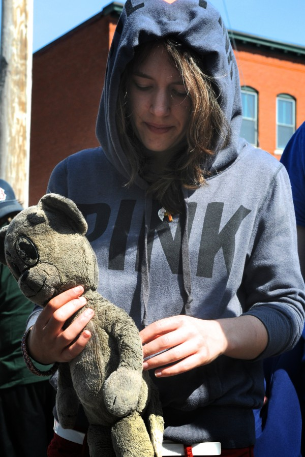 Jericah Potvin holds a stuffed animal she's owned since her first birthday Friday morning April 20, 2012, outside the scene of a fire in Gorham Thursday night, where she and her roommates lived, above the Gorham House of Pizza on Main Street. Potvin was allowed inside this morning and found her waterlogged stuffed animal.