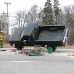 Hancock man injured when pickup rolls over