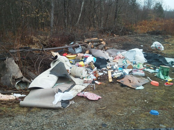 This allegedly illegal pile of trash was discovered in April 2012 on the West Shore Road in Otis. After an investigation by Maine Forest Service rangers, Daniel Smith, 25, of Ellsworth was summoned on a charge of illegal dumping. Smith is one of two men recently charged by the service with illegal dumping near Beech Hill Pond.