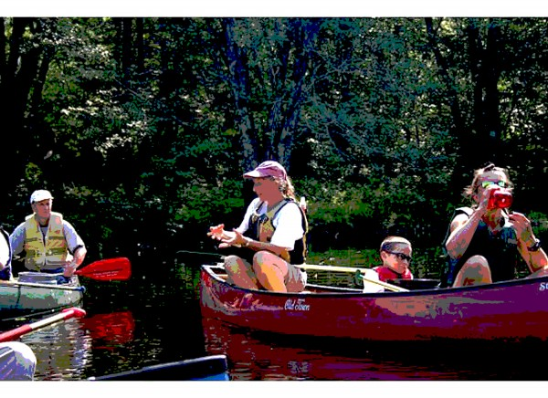 Gudrun Keszöcze, naturalist of Hirundo Wildlife Refuge in Alton and Old Town, talks about bryozoan colonies while guiding a canoe tour on Pushaw Stream in August 2011. The photographer has used his artistic license to alter this photo to appear as an illustration.