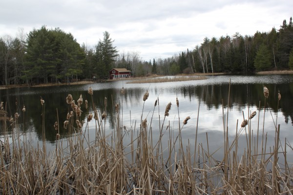 The Parker Reed Shelter, the hub of activity at the Hirundo Wildlife Refuge in Alton and Old Town, can be seen across Lac D''Or, a man-made lake built by the preserve's founder, Oliver Larouche. The water is calm on April 5, 2012.