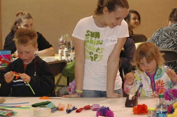 A volunteer helps children get creative with tissue paper and pipe cleaner at last year's HOPE Festival. This year's edition of the event will be held Saturday, April 21, at the University of Maine.