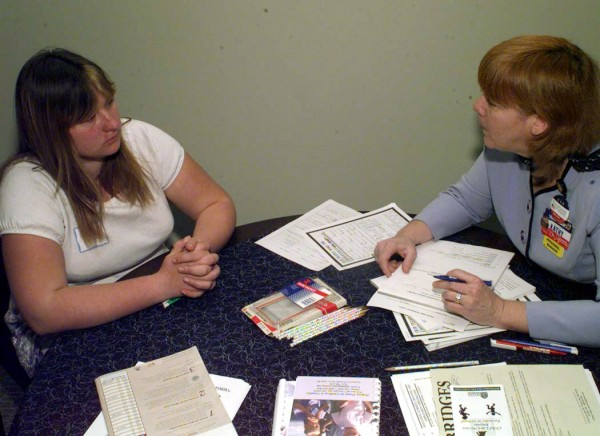 Kristy Warble (left), a junior at Hodgdon High School, participates in a mock job interview with Kathleen King, personnel manager at the Walmart store in Houlton in November 2001.