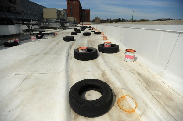 Truck and car tires line the roof of the Penobscot Judicial Center in Bangor on Friday, April 20, 2012. The tires are used to hold the rubber roof in place after it started to delaminate and ripple in the wind.