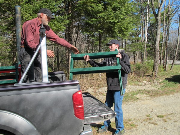 Joey Branch (right), a participant in the KidsPeace program in Ellsworth, hands a homemade sawhorse to Brian Keegstra with Great Pond Mountain Conservation Trust in Orland on Thursday, April 19, 2012. Branch is one of about 10 KidsPeace participants who have been making the sawhorses for the trust and other nonprofit organizations as part of a unique KidsGiveBack Forestry Program.