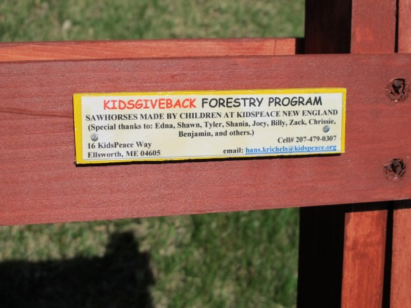 Each sawhorse made by KidsPeace participants in Hancock County bears a tag describing the program and the people who helped build the sawhorse.