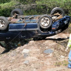 Pulp truck pushes car off road, into ditch in Farmington