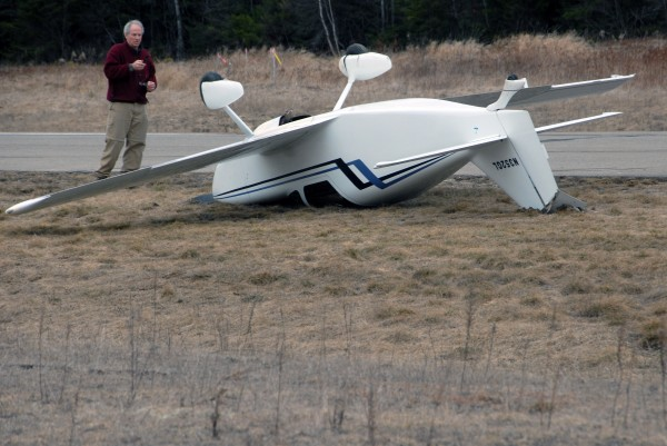 Its co-owner, Mark Weatherbee of Lincoln, looks over the Glasair 1 airplane that went off the runway at Lincoln Regional Airport and flipped over on Sunday, April 1, 2012.