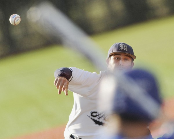 Maine baseball player Eric White pitches to the plate against Colby in the fourth inning of their game in Orono on Tuesday, April 10, 2012.