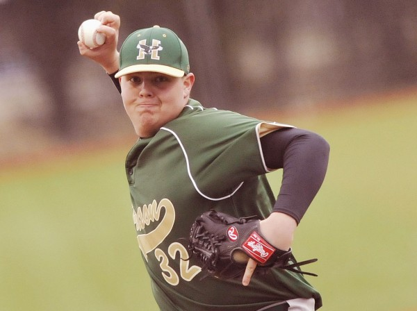 Husson University pitcher Tim Nason (32) delivers to the plate in the fourth inning of their game against UMaine in Orono, Maine, Wednesday, April 4, 2012.