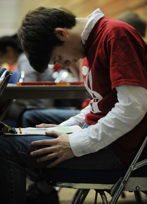 Liam Perry a member of the Bangor High School math team concentrates on solving a math problem during the relay portion of the 36th annual Maine Math Meet at the Bagnor Auditorium on Tuesday, April 10, 2012.