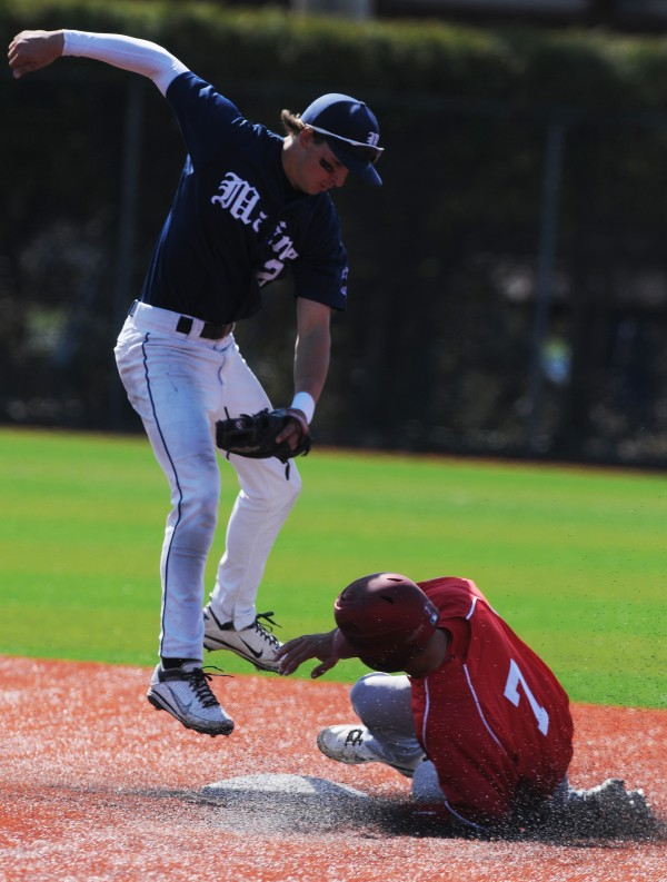 UMaine's Michael Fransosco misses a tag on Hartford's Trey Stover during seventh inning action at the University of Maine on Sunday, April 15, 2012.