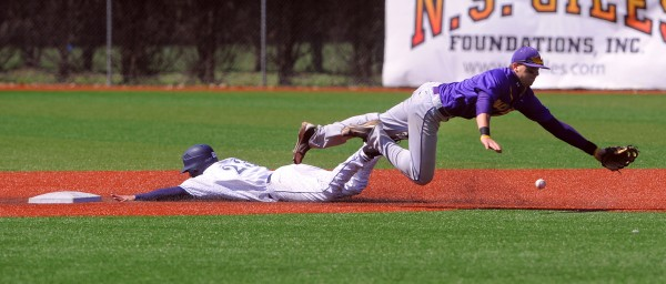 The University of Maine's Colin Gay (left) slides to second base as Albany's Jeff Welsh dives for the ball during the fifth inning of the game in Orono on Saturday, April 28, 2012.