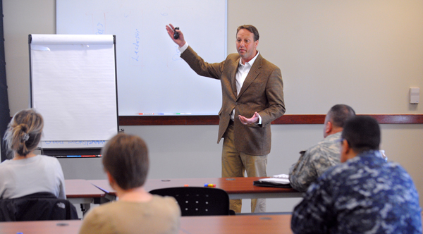 Drew Wing, the executive director of the Portland-based organization Boys to Men, speaks during a presentation at the Bangor Regional Training Institute on Monday, April 30, 2012. The Maine National Guard hosted the presentation which was attended by people from the Maine National Guard and civilian organizations.