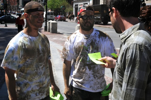 Muddy USM students Brett Kapteina (left) and Dan Rautenberg hand out fliers in downtown Portland on Thursday, April 19, 2012 to promote the Into the Mud Challenge.