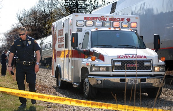 Police and rescue personnel respond to a fatal accident on the Amtrak tracks off Main Street in Biddeford on Monday.
