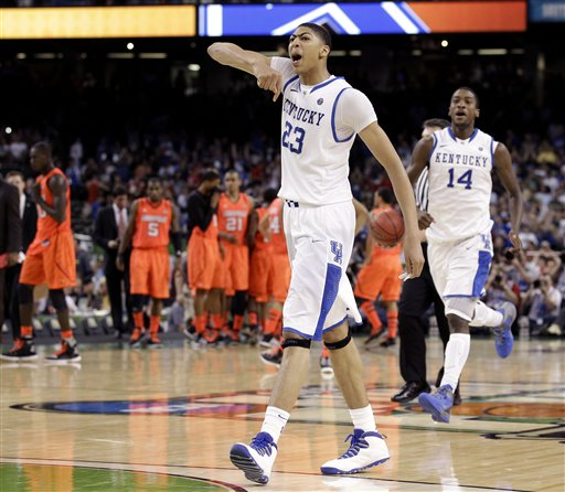 Kentucky forward Anthony Davis (23) reacts after defeating Louisville 69-61 in an NCAA Final Four semifinal college basketball tournament game Saturday.