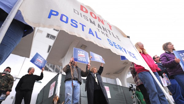 About 30 people participated in a demonstration to stop Congress from dismantling  the U.S. Postal Service. The event was held outside the Federal Building in Bangor on Thursday, April 12, 2012, but similar demonstrations were held in five other cities in Maine as well as across the counry.