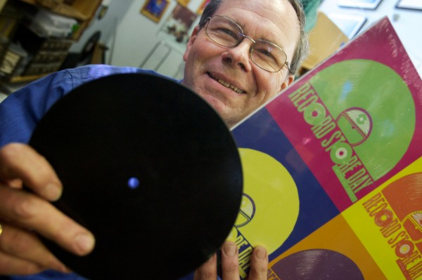 Dave Hunt of Vinylhaven Records on Maine Street in Brunswick holds one record from 1889 (left) and one from 2009. &quotThe record's demise has been greatly exaggerated,&quot he said. He'll be celebrating Record Store Day on Saturday with raffles, doughnuts and live music.