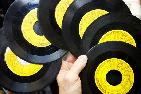Proprietor of Vinylhaven Records on Maine Street in Brunswick, Dave Hunt, holds six original Sun Records by Jerry Lee Lewis, Johnny Cash and Billy Riley on Tuesday, April 17, 2012. He'll be raffling them off this Saturday as part of his Record Store Day celebration.
