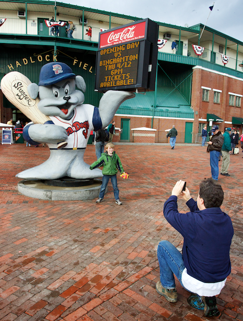 Michael Rogers of Portland takes his son Brendan's photo outside Hadlock Field Thursday, April 12, 2012, before the Portland Sea Dogs' home opener.