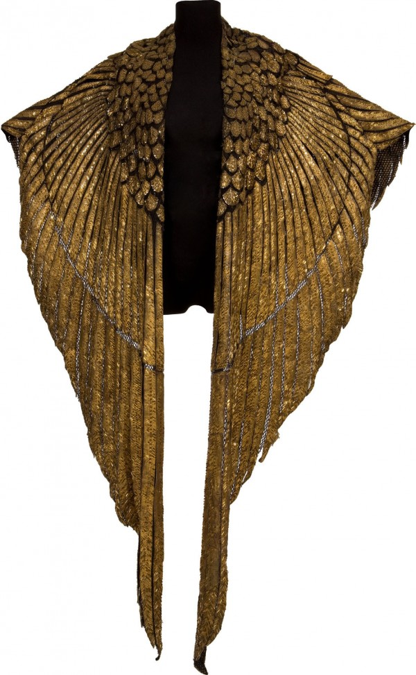 The gold cape that Elizabeth Taylor wore as Cleopatra in the 1963 film of the same name recently sold for $59,375 at Heritage Auctions in Dallas.