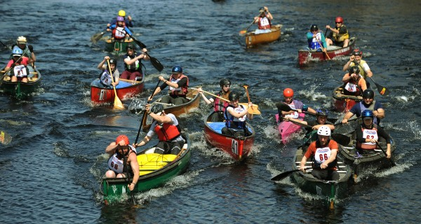 Competitors in the Souadabscook Stream canoe race paddle hard during the mass start in Hampden on Saturday, April 14, 2012.