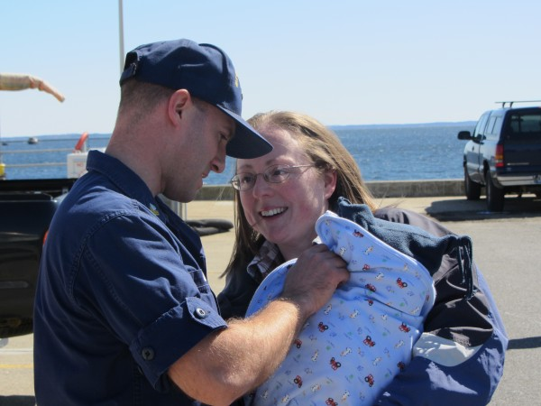 Boatswain's Mate First Class Aaron Given gets to see his child Judah and wife Rachel upon his return from a four-month deployment on the Thunder Bay.