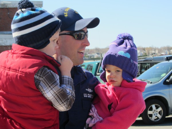 Chief Boatswain's Mate Matt Deane holds children Mason (left) and Ava.