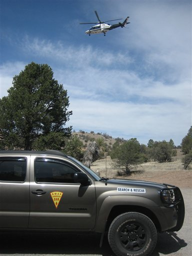 search and rescue teams, including dog teams, horse teams, a National Guard helicopter and a Civil Air Patrol fixed-wing aircraft scour the wilderness surrounding the Gila Cliff Dwellings in search for missing runner Micah True, in Silver City, N.M.