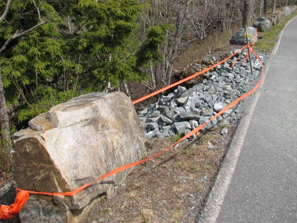 Orange tape marks the spot on Wednesday, April 25, 2012, where part of a roadside embankment along Duck Brook Road in Acadia National park fell away the previous week. Fixing the collapse could cost $52,000. Acadia officials said Wednesday, but the presence of a water main that serves downtown Bar Harbor in the embankment could complicate the project. The road where the collapse occurred is closed indefinitely to vehicular traffic.