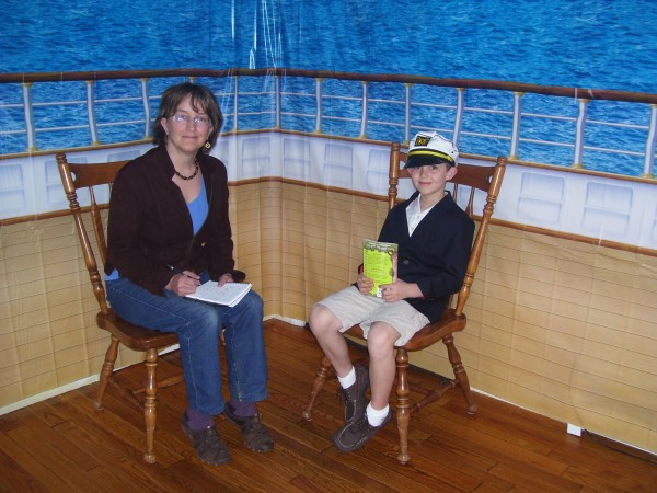 Nathan Carey (right), 8, sits for an interview with columnist Robin Wood (left) at his home. The living room was decorated to commemorate the 100th anniversary of the sinking of the RMS Titanic on April 15th, 1912.