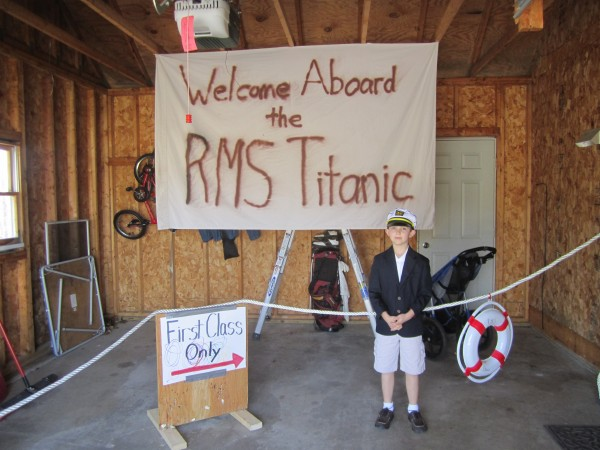Nathan Carey, 8, dressed as the Titanic's Capt. Edward John Smith, welcomes people into his home through the garage. Nathan held a 100th anniversary commemoration and gave a presentation in honor of the great ship.